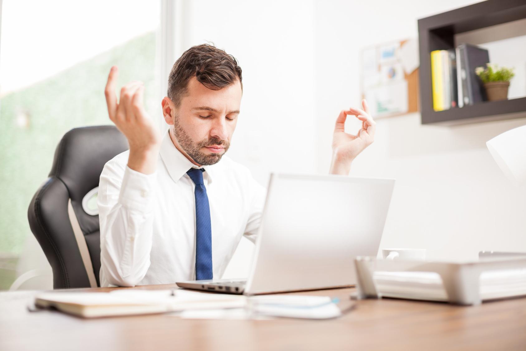 office meditation. Office Meditation. Businessman Meditating At His Desk Meditation